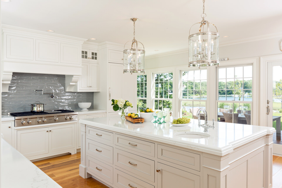 A beautiful waterfront home in Harwich showing an example of a Traditional range hood style